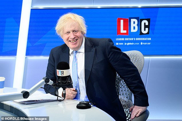 Boris Johnson did not condemn his father today, telling LBC Radio (pictured): 'I think you really ought to raise that with him. I am not going to get into details of family conversations'
