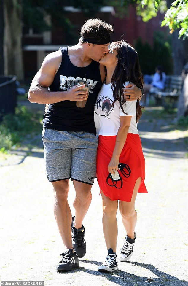 Kiss kiss: Roxanne Pallett and her husband Jason Carrion looked happier than ever as they shared a passionate kiss during a romantic walk in a New York park on Friday