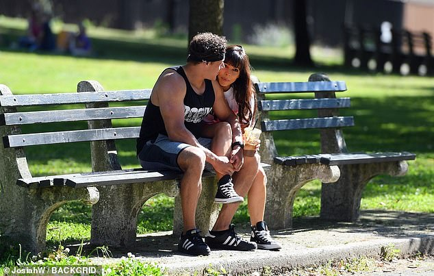 Chill: At one point, the duo stopped and rested on a bench, with the actress barely able to keep her hands off the hunk as she draped her leg over him