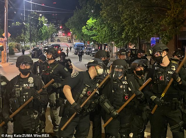 Police pepper sprayed protesters and arrested 25 people for refusing to leave Seattle's reclaimed Capitol Hill Organized Protest (CHOP) zone on Wednesday night