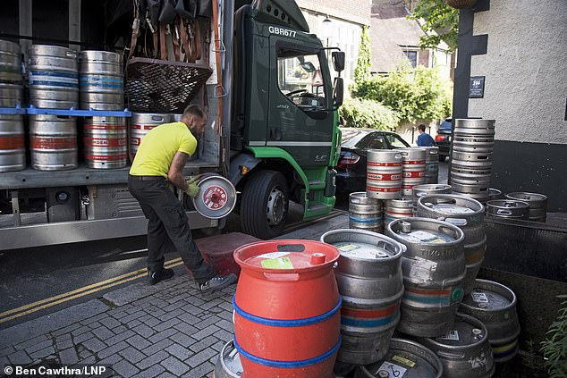 Beer barrels arrive at the Windsor Castle pub in South Kensington ahead of pubs reopening tomorrow. The government is waiting anxiously to see how people react to a further relaxation of lockdown rules