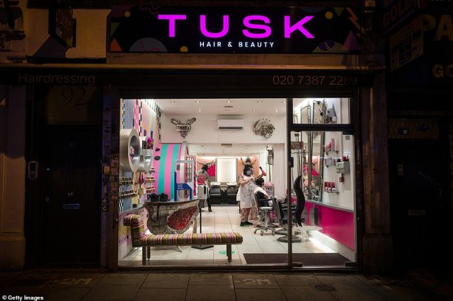 Tusk Hair stylists are seen working with customers in Camden just after midnight