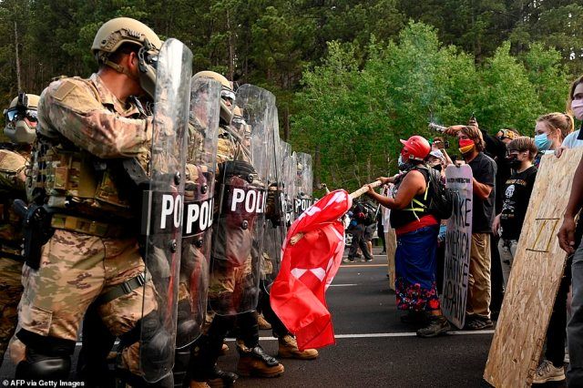 Authorities declared an 'unlawful assembly' before police and National Guard soldiers moved in and a standoff ensued