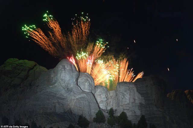 Fireworks explode above the Mount Rushmore National Monument during Friday's Independence Day event