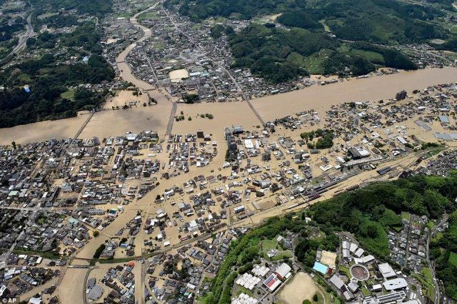 Areas are inundated in muddy waters that gushed out from the Kuma River in Hitoyoshi, Kumamoto prefecture, southwestern Japan