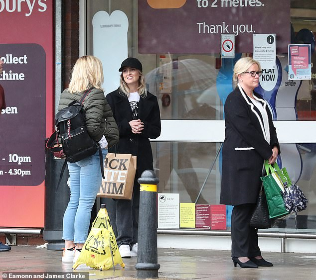 Chit chat: the star seemed relaxed as she chatted with Wendy as they joined the socially distant queue, before heading to their store