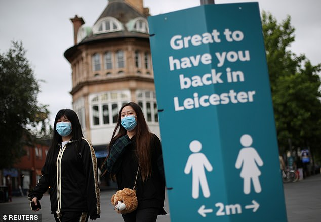 DR ELLIE CANNON: Lockdowns such as the one in Leicester, as painful as they'll be, are the way we're going to avoid a second wave (pictured, people wearing face masks in Leicester)