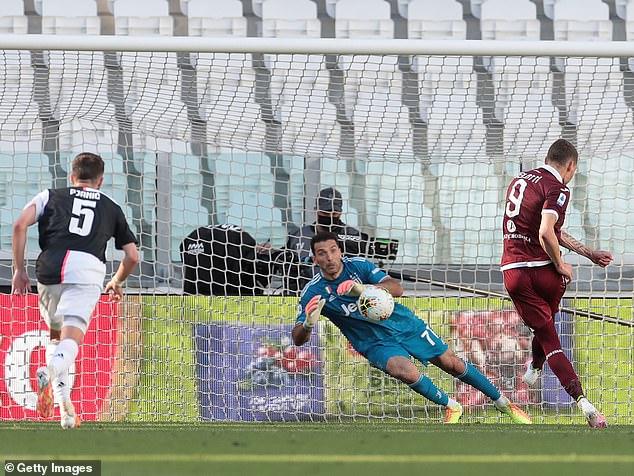 Andrea Belotti (right) beats Juve stopper Gianluigi Buffon as Torino level just before half-time