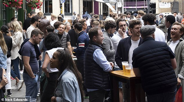 Pubs across England were allowed to reopen as of Saturday, as coronavirus locking restrictions have been relaxed. Pictured: Revelers outside the Market Porter Pub in Borough Market, central London