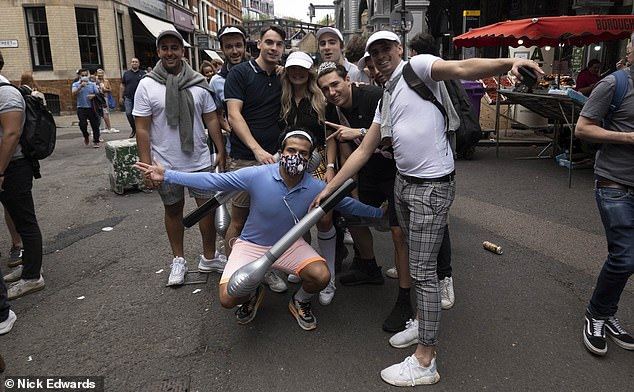 Some, such as this group in London, took the opportunity to play 'pub golf', a game in which pub-goers move from watering hole to watering hole trying to finish their drinks in as few sips as possible