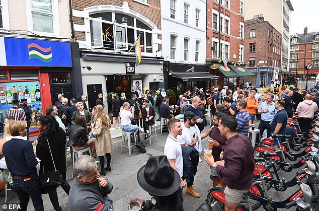 The streets of Soho in London were packed with pub-goers enjoying the reopening of bars and pubs today
