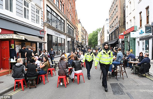 Police officers out on patrol through Soho in London as drinkers return to the pubs for the first time since lockdown began