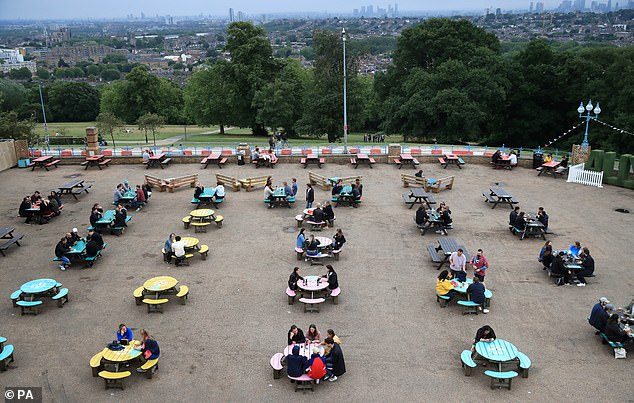 Social distancing rules were very much in place at the Alexandra Palace Terrace bar, with tables spaced out more than two metres apart