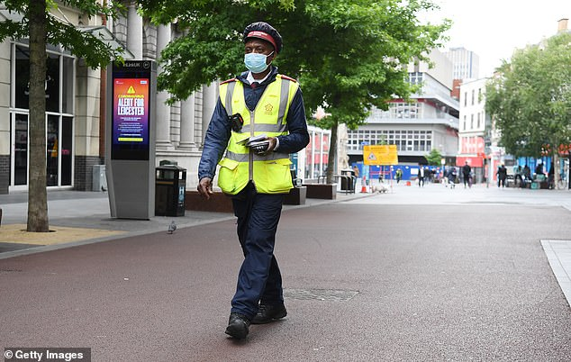 A civil enforcement officer patrols the city centre as lockdown continues in Leicester on Saturday
