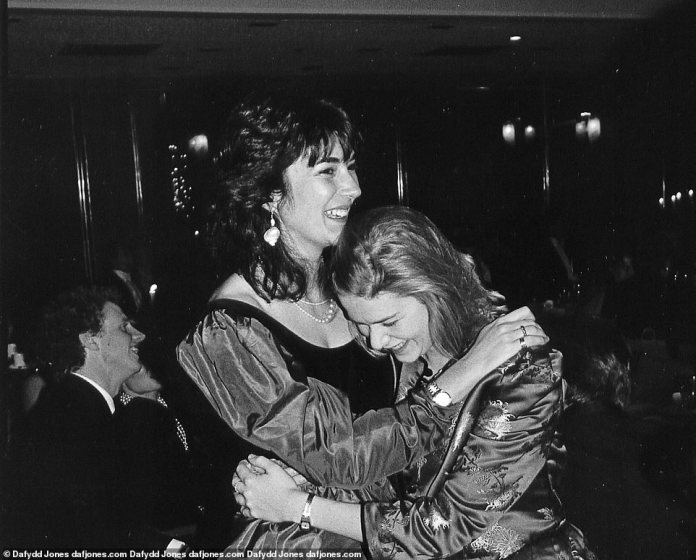 Gala Girls: Ghislaine Maxwell (left) hugs aristocrat daughter Ariadne Beaumont (right) at a social event