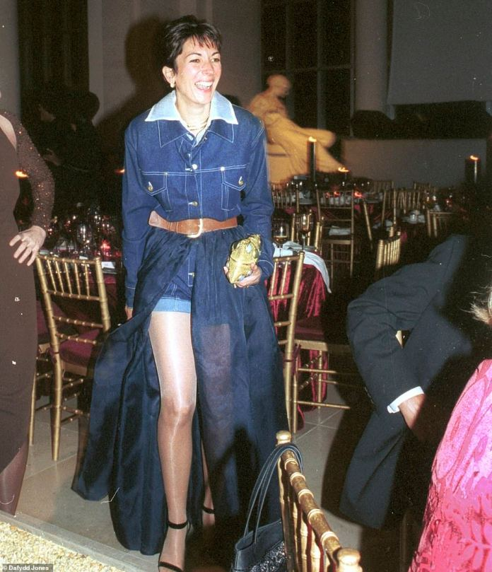 Daring in Denim: Ghislaine Maxwell amazes in a superb blue dress at the Met's gala ball in New York in December 2003