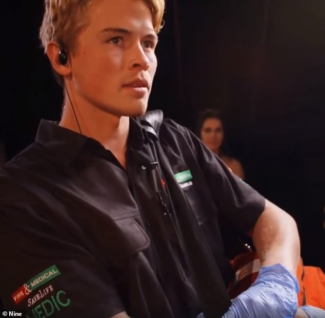 On duty: Xavier was waiting in the wings with his emergency medical bag and looked on concerned as Apollo's arm caught on fire during the stunt