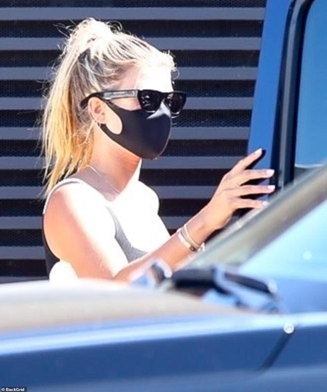 Different look: Sofia donned a mask inside the restaurant and had her hair up in a ponytail