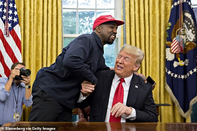Kanye infamously revealed his support for Donald Trump in 2018 before paying a visit to the White House that October (pictured)