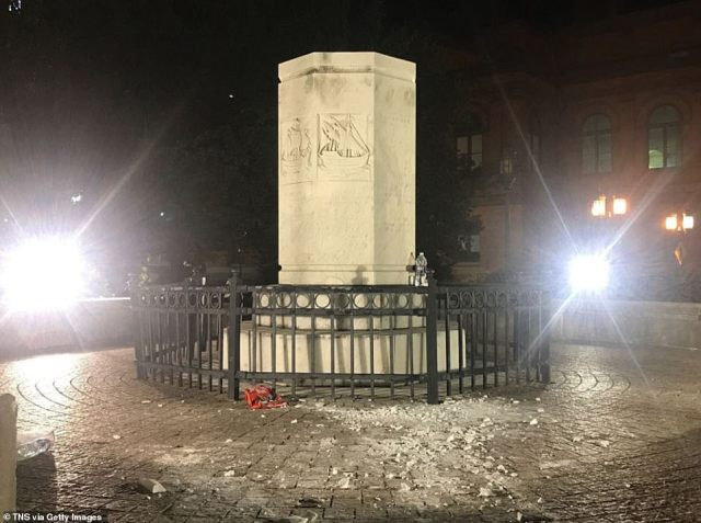 The empty plinth is all that remains after the statue was torn down on Saturday evening by a group of protesters in Baltimore, Maryland