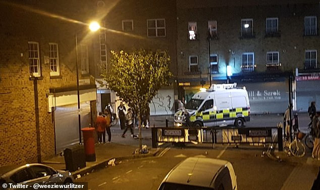 A police van pictured on the scene as drinkers are moved on and sent home