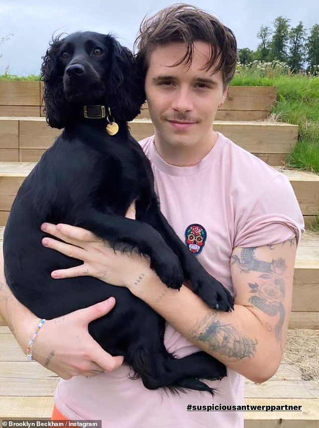 Furry friend: Brooklyn himself had previously marked his return home as he shared a picture of himself reuniting with one of the family's pet dog Fig