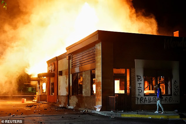 The image above shows a Wendy's restaurant in Atlanta burning after it was set on fire by arsonists on June 13