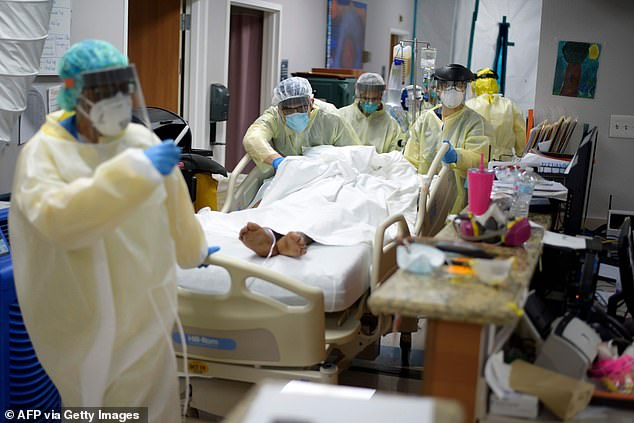 At least 60% of people need to have contracted the virus for it to not be able to spread throughout a community. Pictured: Healthcare workers move a patient in the Covid-19 Unit at United Memorial Medical Center in Houston, Texas, July 2