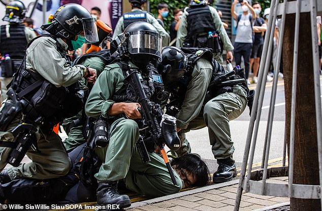 TikTok's announcement comes after a security crackdown in Hong Kong (pictured, a protester is pinned down by riot police in the city last week)