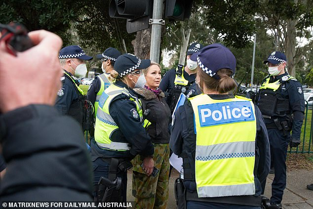 Police detain a protester on Tuesday in Flemington