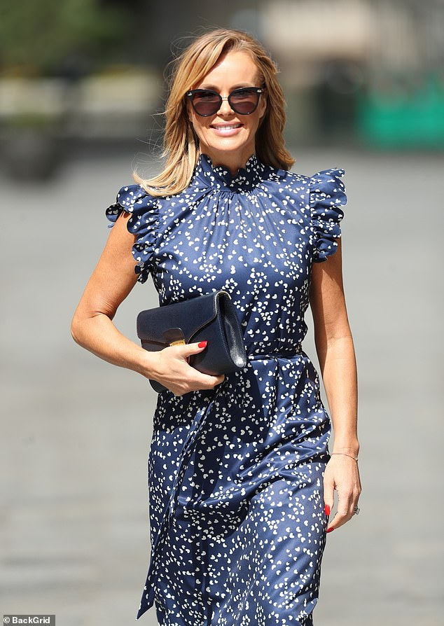 Sensational:The Britain's Got Talent star, 49, caught the eye as she slipped into a navy spotted dress by Anne-Louise Boutique