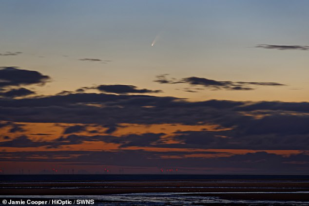 The comet C2020 F3 NEOWISE is seen above the horizon from Brancaster beach, Norfolk UK, July 6 2020.To view the comet in the UK you'll need to stay up late or get up early as it is best viewed at about 02:30 BST in the north-east sky anywhere in the country