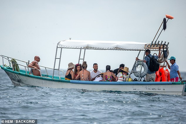 Out of the yacht: They were seen in a smaller boat as they were returning to shore