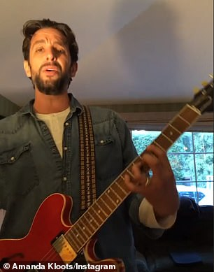 In a succession of videos, the 41-year-old riffs the blues on an orange electric guitar, crooning 'You only love me when I say goodbye. Only the heavens above me know the reasons why', improvising as he plays.