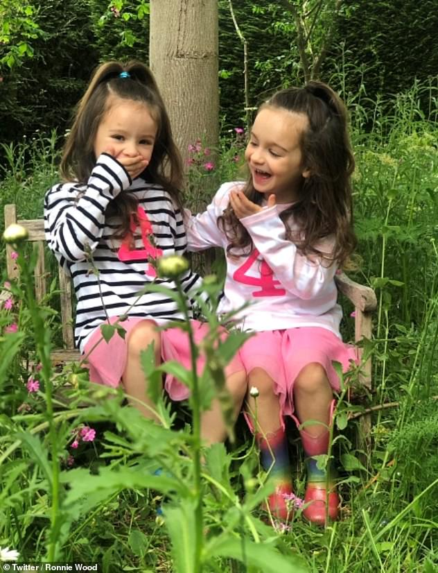Growing up: musician Ronnie and the daughters of his wife, the actress, Alice and Gracie, are now four years old (photo for their birthday in May)