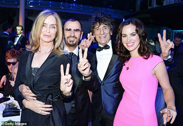 Close friends: Another photo shows brunette beauty Sally, 42, posing for a comfortable snapshot with her 73-year-old husband, birthday, and movie star Barbara, 72, at the 2014 GQ Awards