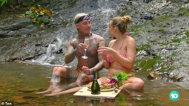 Romantic: The promo begins calmly enough, with Abbie and Ciarran (left) enjoying a romantic date by a waterfall as she says in a voice over: 'He and I are really compatible'