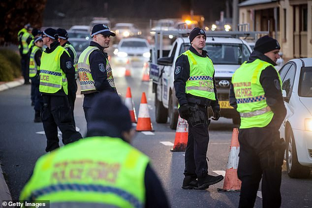The border between VIC and NSW was closed on Tuesday to prevent the second wave of COVID-19 in Melbourne from spreading to the neighboring state.  Police are pictured arresting and interrogating drivers at a checkpoint on July 8 in Albury