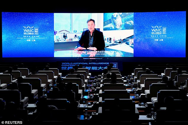 Tesla CEO Elon Musk told an artificial intelligence conference in China this past July that his company is 'very close' to achieving complete autonomous driving technology. Musk is seen above via a video message at the opening of Shanghai's annual World Artificial Intelligence Conference