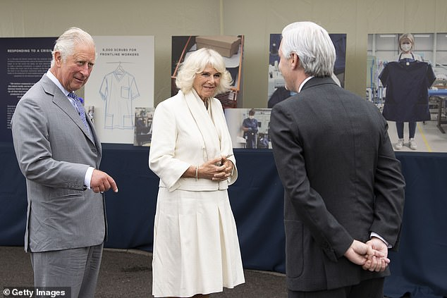 Charles and Camilla's visit was held in the car park of the company's factory in the Quedgeley area of Gloucester. Pictured, together