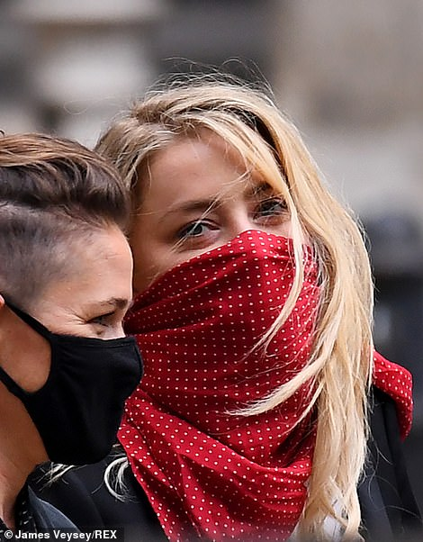 Amber Heard and her girlfriend Bianca Butti leave the High Court of Justice on the third day of Johnny Depp's trial against The Sun