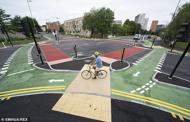 Instead of turning right, creating a risk with ongoing and sometimes oncoming traffic, cyclists will be encouraged to go around the outside of the junction using the green-coloured cycle track