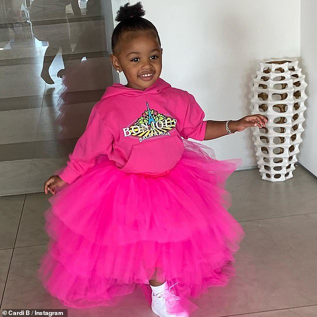Pretty in pink:Cardi B shared cute Instagram snaps of daughter Kulture in a huge pink tutu and matching hoodie to mark her 2nd birthday