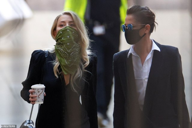 Depp's ex-wife Amber Heard, 34, arriving at the High Court this morning with her girlfriend Bianca Butti (right)