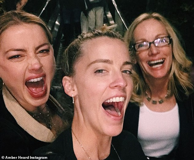 Amber (pictured left) with her younger sister and their mother Paige. The actress revealed in May that her mother had died