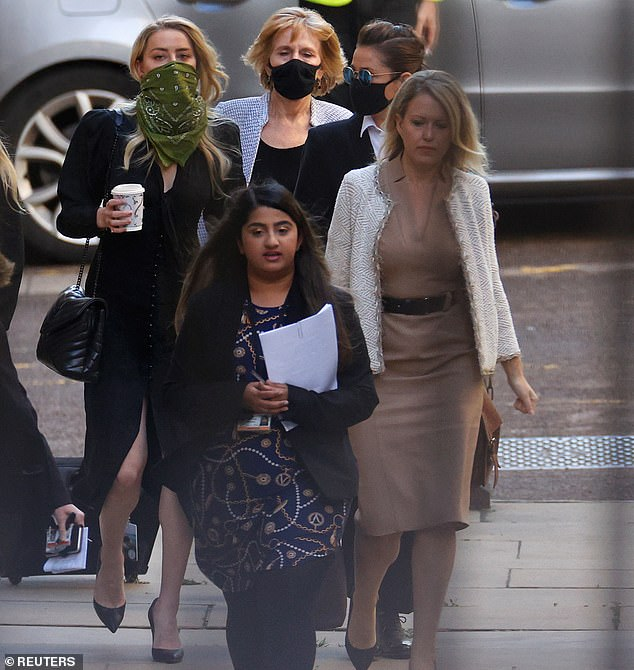 Jennifer Robinson (pictured right, in a brown dress) is a leading human rights lawyer from Doughty Street chambers who also represents Julian Assange
