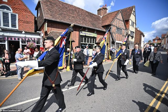 Members of the public gather in the town of Ditchling, East Sussex, to pay their respects ahead of the funeral of Dame Vera Lynn