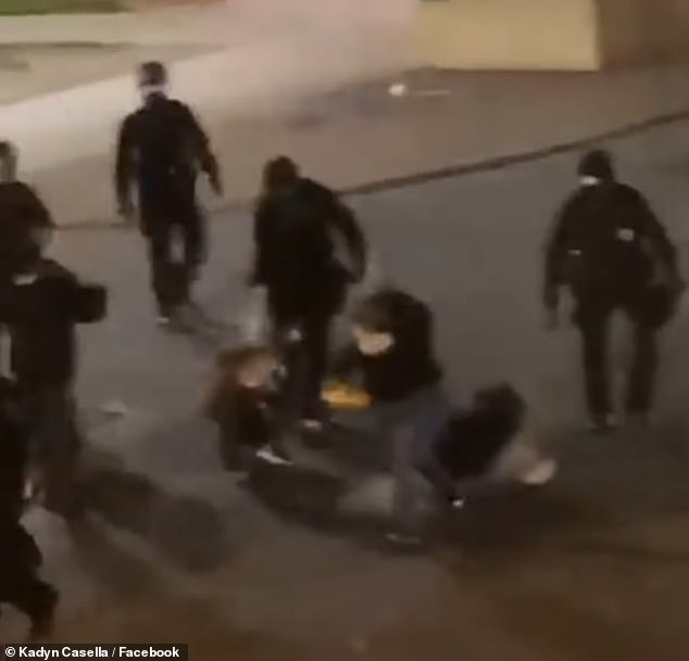 The officer who kicked Sillsbaugh (center) was suspended for three days without pay and will remain on desk duty until he completes sensitivity training