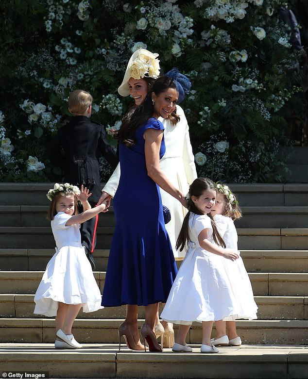 Meghan is said to have failed to get in touch with her goddaughter Ivy on her birthday last month. Ivy was in her wedding to Prince Harry. Pictured with Princess Charlotte