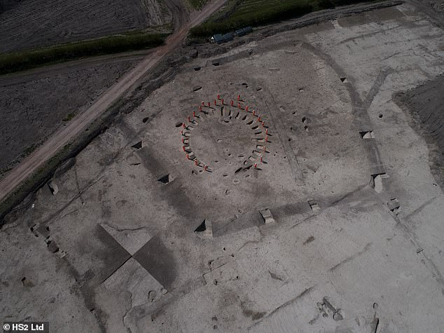 'We already knew that Buckinghamshire is rich in archaeology — but discovering a site showing human activity spanning 4,000 years came as a bit of a surprise to us,' said project archaeologist Rachel Wood. Pictured, archaeologists stand on the outline of a horse shoe -shaped funerary enclosure believe to date back to the Iron Age